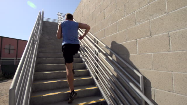 a man running stairs. - super slow motion - filmed at 240 fps - steps and staircases stock videos & royalty-free footage