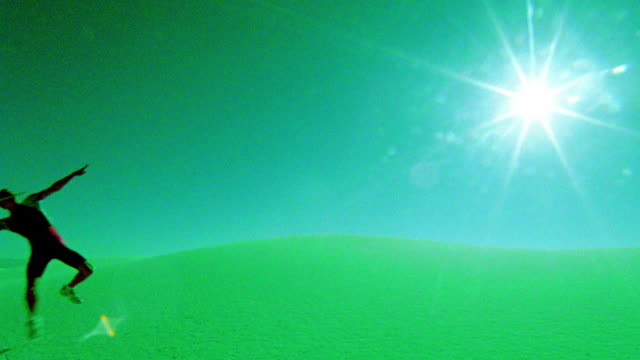 green selective focus man running + throwing javelin in desert / white sands, new mexico - javelin stock videos & royalty-free footage
