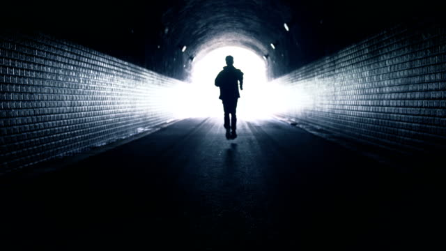 man running toward light - concentric stock videos & royalty-free footage