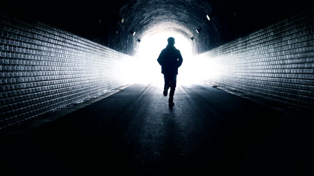 man running toward light - hope stock videos & royalty-free footage