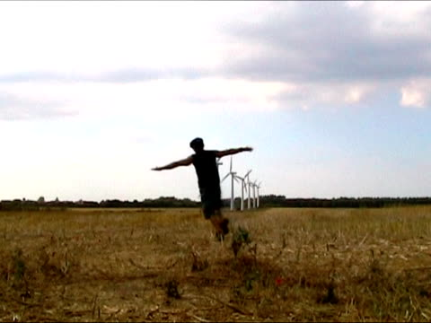 man running towards row of wind turbines - human limb stock videos & royalty-free footage