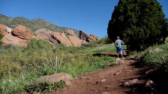 man running trading post trail red rocks park morrison colorado rocky mountains - red rocks stock videos & royalty-free footage