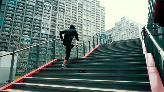 Man running up staircase