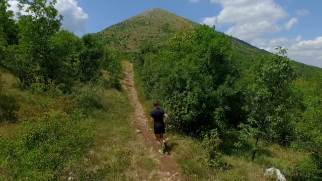 man running uphill - uphill stock videos & royalty-free footage