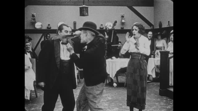 1918 Man (Buster Keaton) runs and hides from intruding tramp before head waiter approaches with knife and is attacked for his troubles