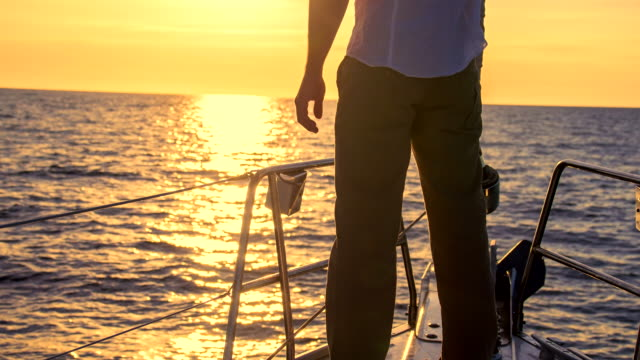MS Man Sailing At The Sunset