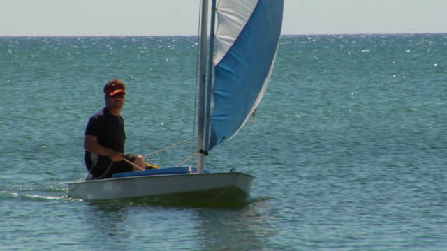 ms, man sailing in small boat, north truro, massachusetts, usa - sun visor stock videos and b-roll footage