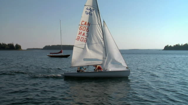 ms pan ts man sailing through sea / chester, noviscocia, canada - セールボート点の映像素材/bロール
