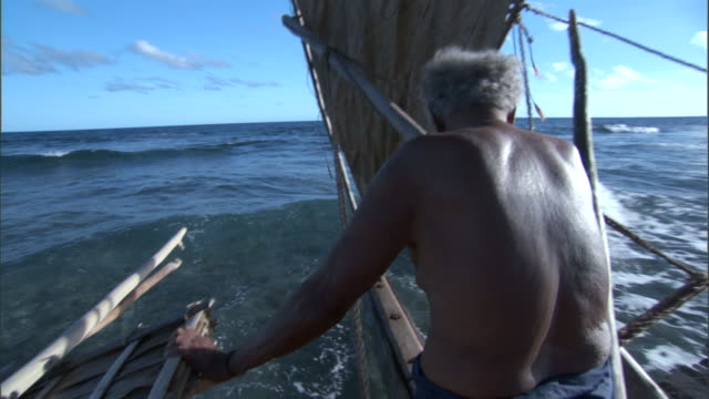 man sails on outrigger canoe, duff islands, solomon islands - pacific islands stock videos & royalty-free footage