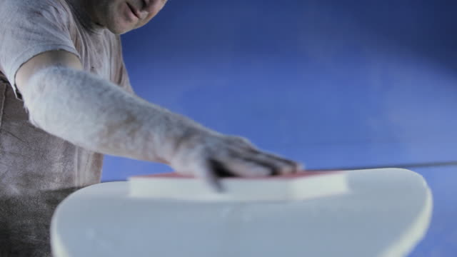 man sanding new surfboard - only mature men stock videos and b-roll footage