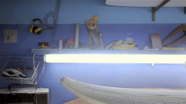 man sanding new surfboard - only mature men stock videos & royalty-free footage