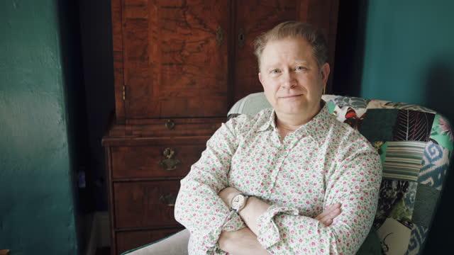man sat in chair looking at camera - shirt stock videos & royalty-free footage