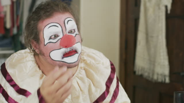 man satisfied trying on red nose for clown costume / cedar hills, utah, united states - mirror stock videos & royalty-free footage