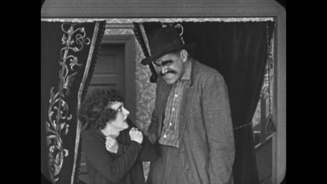 1921 man saves woman by sending villain through trap door - schurke stock-videos und b-roll-filmmaterial