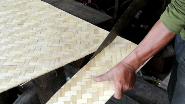 man sawing bamboo plywood sheet - bamboo plant stock videos & royalty-free footage