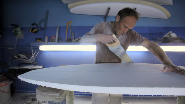 man sawing new surfboard - only mature men stock videos & royalty-free footage