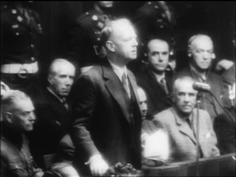 b/w 1946 man saying plea into microphone in courtroom at war crimes trials / nuremberg / newsreel - processi di norimberga video stock e b–roll