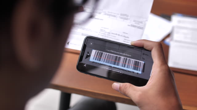 a man scans the qr code for paying bill online - examining stock videos & royalty-free footage