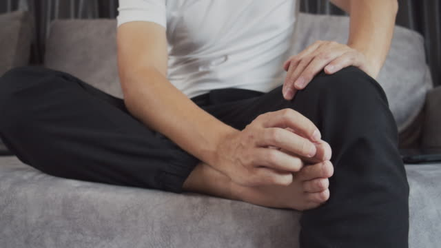 man scratching on his itchy foot.healthcare and medical concept. - toe stock videos & royalty-free footage
