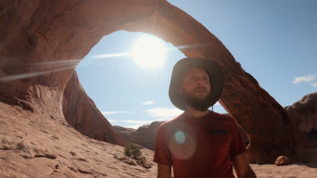man selfie video in the great southwest usa,  under corona arch - moab utah stock videos & royalty-free footage