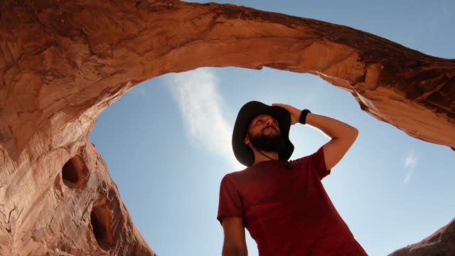 man selfie video in the great southwest usa,  under corona arch - arch stock videos & royalty-free footage
