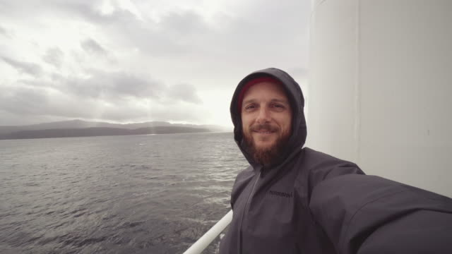 man selfie video on deck of a vessel in a rough sea - ferry deck stock videos & royalty-free footage