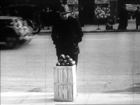 b/w 1929 man selling apples on city sidewalk / great depression / newsreel - 1929 stock videos & royalty-free footage