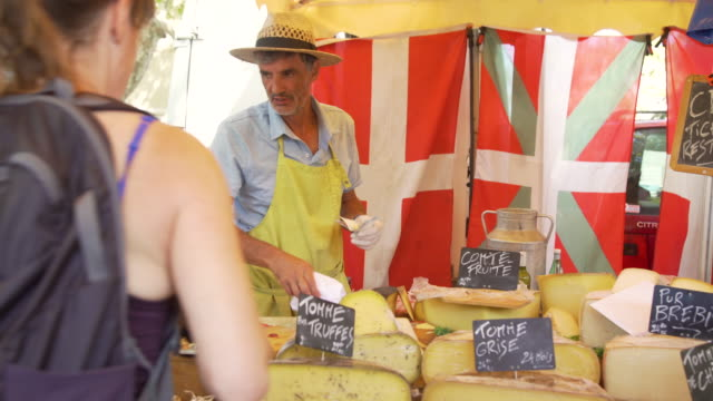 man selling cheese at street market at montpellier, france - french culture stock videos & royalty-free footage