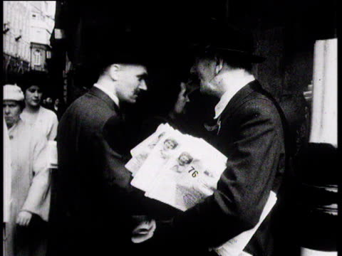 man selling newspapers to businessmen commuters go down stairs of underground city of london; 1957 - city of london stock videos & royalty-free footage