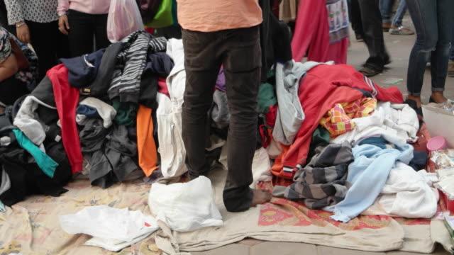 a man selling sweat shirts at sarojini nagar market in delhi, india - sweatshirt stock videos and b-roll footage