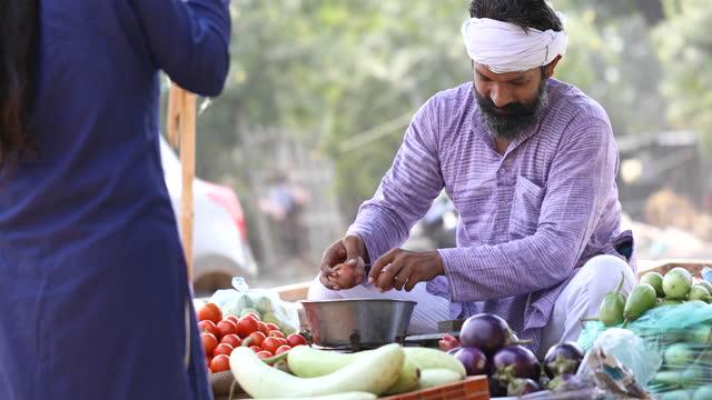 man selling vegetable on street cart - image stock videos & royalty-free footage
