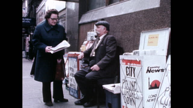 man sells newspapers on a street in the city of london; 1975 - moustache stock videos & royalty-free footage