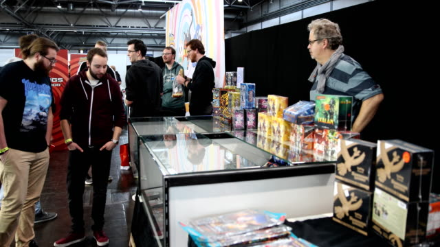 man sells the great card game pokemon to the visitors at the 2018 dreamhack video gaming festival on january 27, 2018 in leipzig, germany. the... - pokémon stock videos & royalty-free footage