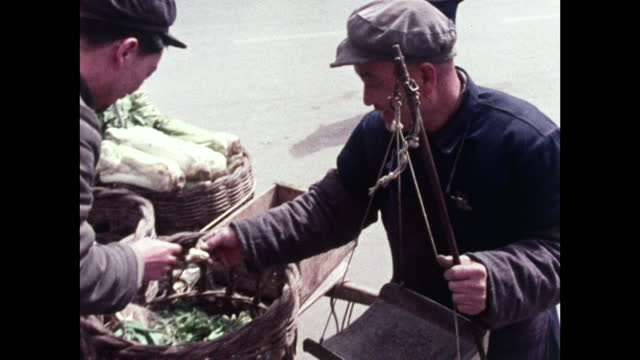 man sells vegetables from a handcart in beijing; 1973 - maoism stock videos & royalty-free footage
