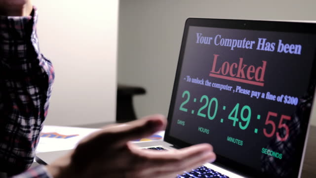 Man serious computer locked by ransomeware