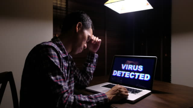 Man serious with Computer Virus detected