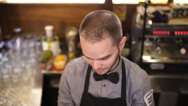 Man serving beer at pub