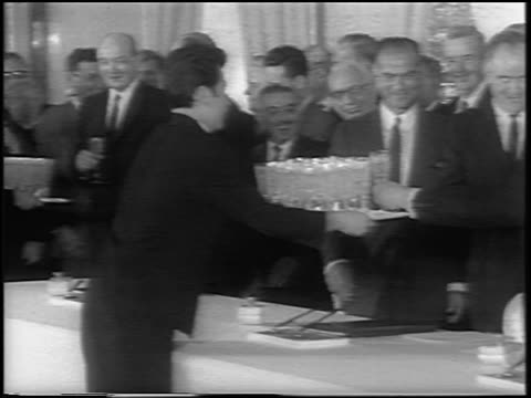 b/w 1963 man serving champagne to world leaders at signing of the atomic test ban treaty / newsreel - anno 1963 video stock e b–roll