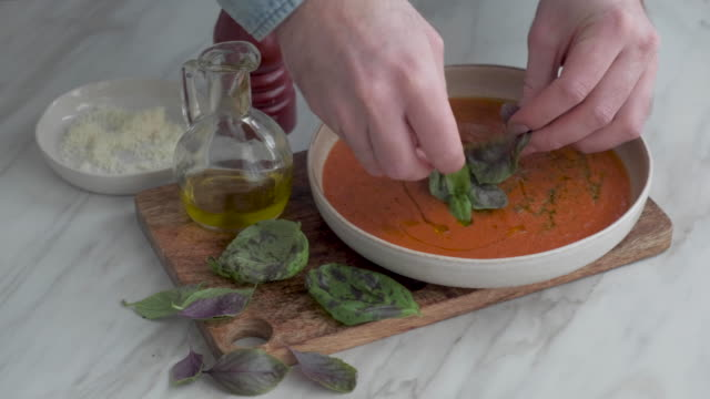 man serving italian tomato soup - recipe stock videos & royalty-free footage
