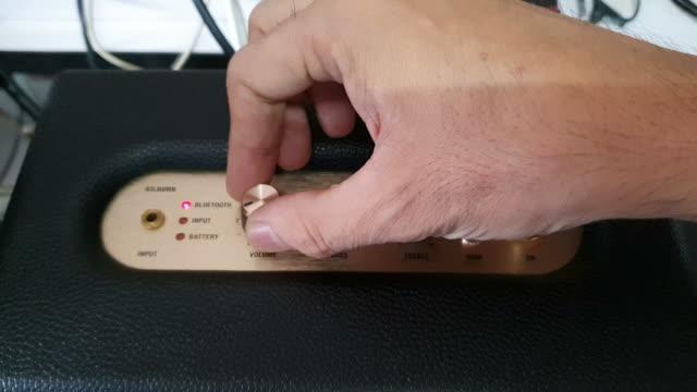 man setting bluetooth speaker - bluetooth stock videos & royalty-free footage