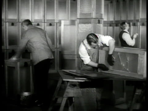 man setting up poll booth ws inspecting ballot boxes ext ws president franklin 'fdr' roosevelt riding in convertible car int republican nominee aft... - 1936 bildbanksvideor och videomaterial från bakom kulisserna