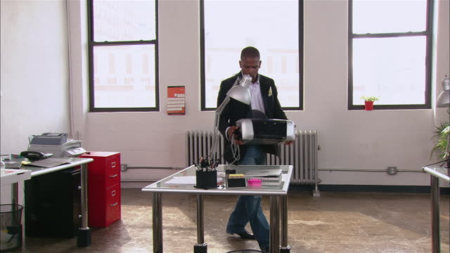man setting up printer on desk in loft office / new york city - printer occupation stock videos and b-roll footage