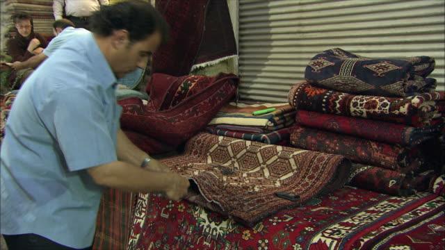 MS Man sewing Persian carpet, Iran