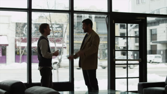 ms man shaking hands with business man and leaving office / provo,utah,usa - provo stock videos & royalty-free footage