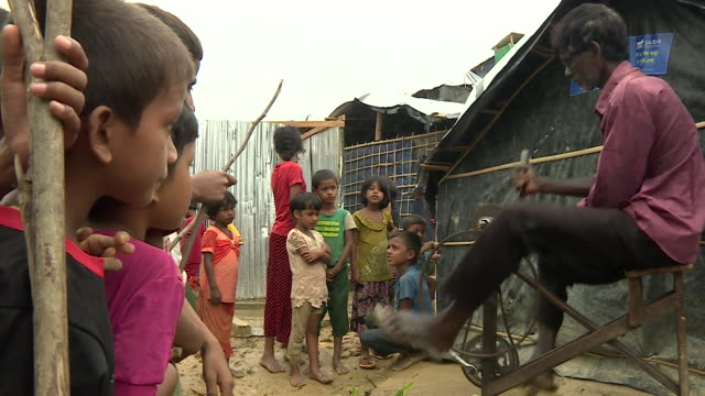 A man shaping a dagger at a Rohingya refugee camp in Bangladesh
