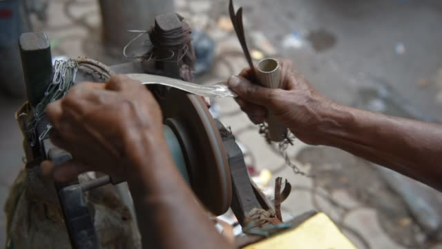 a man sharpening metal blades before the day of muharram in kolkata india on 09 september 2019 muharram is a month of mourning in remembrance of the... - imam hussein stock videos and b-roll footage
