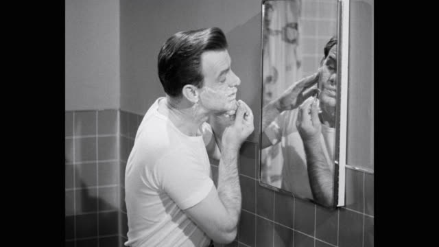 man shaving beard in bathroom with safely razor - body care stock videos & royalty-free footage