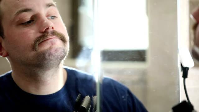 Man shaving gently