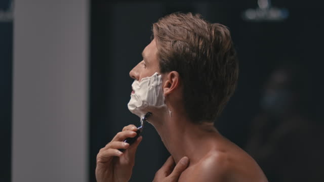 man shaving his face - shaving brush stock videos & royalty-free footage