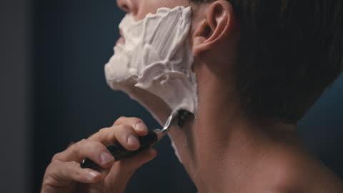 man shaving his face - beard stock videos & royalty-free footage